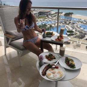 Jackie in Cabo eating brunch