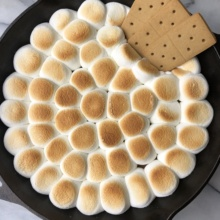 Peanut Butter Cup S'mores Skillet Dip with graham crackers