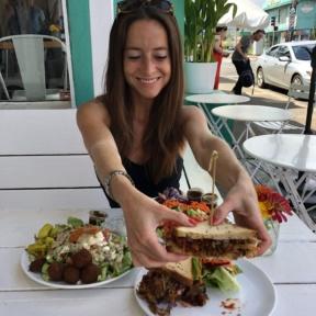 Jackie eating a gluten-free sandwich at Java Kai