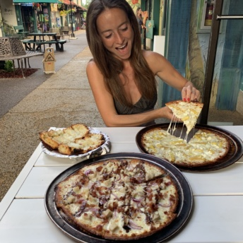 Jackie eating pizza at Hanalei Bay Pizzeria