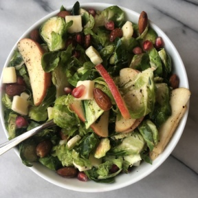 Shredded Brussels Sprouts and Apple Salad with cheddar, almonds, pomegranate