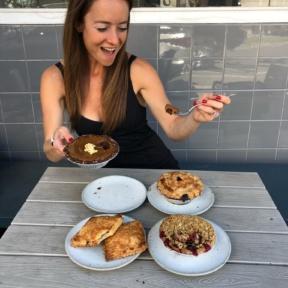 Jackie eating pies at Winston Pies