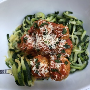 Zoodles and meatballs with parmesan cheese