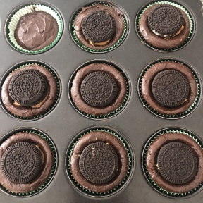 Making gluten-free Peanut Butter Creme Cookie Stuffed Brownie Cupcakes