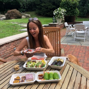Jackie eating food from Catch A Healthy Habit Cafe