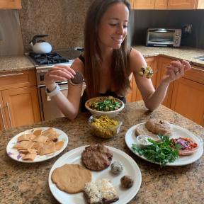 Jackie eating gluten-free food from Skinny Buddha