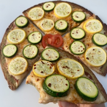 Slice of gluten-free zucchini pizza by Rich's Home