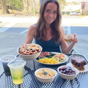 Jackie eating at 100% gluten-free spot KarmaFarm
