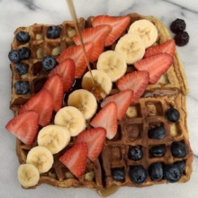 Gluten-free Two Ingredient Waffles with fresh fruit and maple syrup