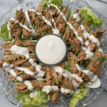 Gluten-free Buffalo Chicken Celery Boats with ranch dressing