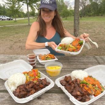 Jackie eating at Hawaiian Bros