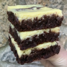 Stack of gluten-free Cheesecake Marbled Brownies