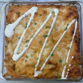 Gluten-free Buffalo Chicken Pasta Bake with ranch drizzle