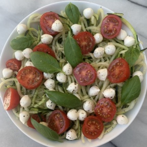Gluten-free Caprese Zoodles with mozzarella, tomatoes, and basil