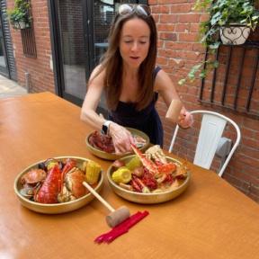 Jackie eating crab at SONO Boil