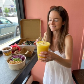 Jackie drinking a smoothie at Root2Rise NY