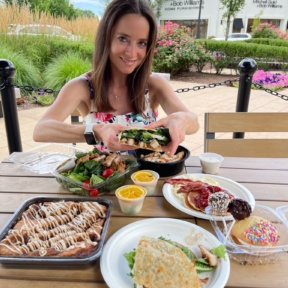 Jackie eating a gluten-free wrap from Twist Bakery Cafe