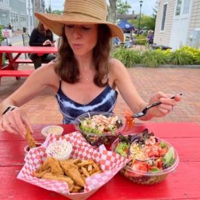 Jackie eating chicken tenders at Lobster Cooker