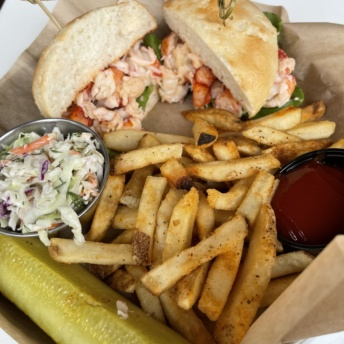 Gluten-free lobster roll with fries from Brix + Brine