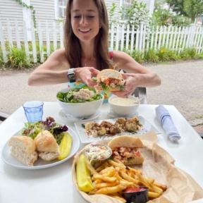Jackie eating lobster at Brix + Brine