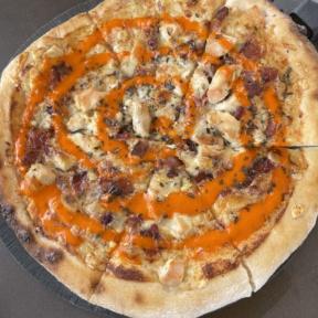 Gluten-free buffalo chicken pizza from Wicked Restaurant