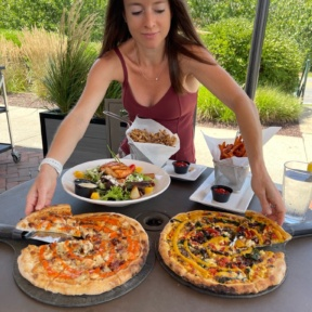 Jackie ready to eat gluten-free pizza at Wicked Restaurant