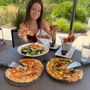 Jackie eating GF pizza at Wicked Restaurant in MA