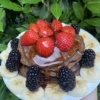 Three ingredient chocolate pancakes with maple syrup
