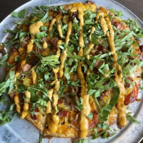 Gluten-free cheeseburger pizza from Pizza Luce